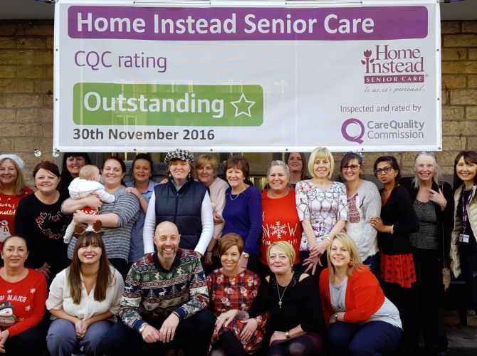 photo of Caregiver team with outstanding banner