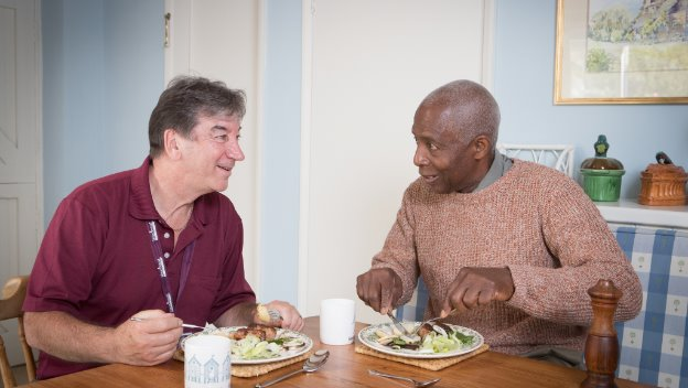 Rotherham CAREGiver dines with elderly person