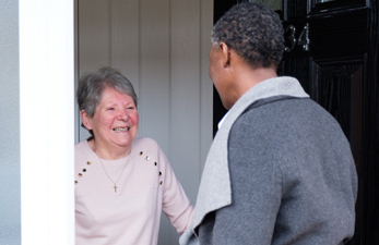 client opens door to caregiver