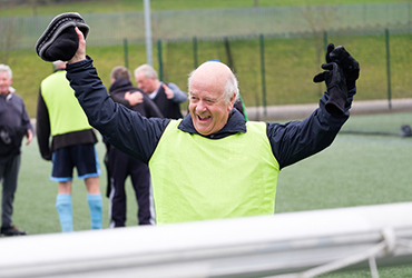 Eldery man celebrating after playing football