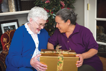client and caregiver receive gift
