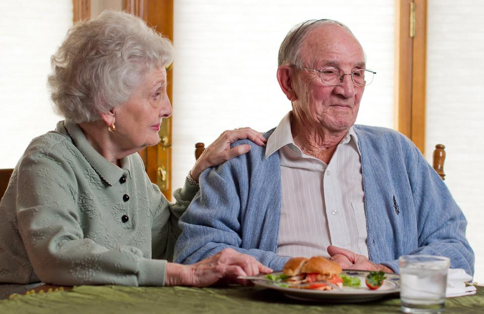 Client and wife sit down to eat