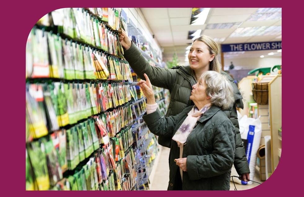 CAREGiver and client shopping in garden centre for seeds