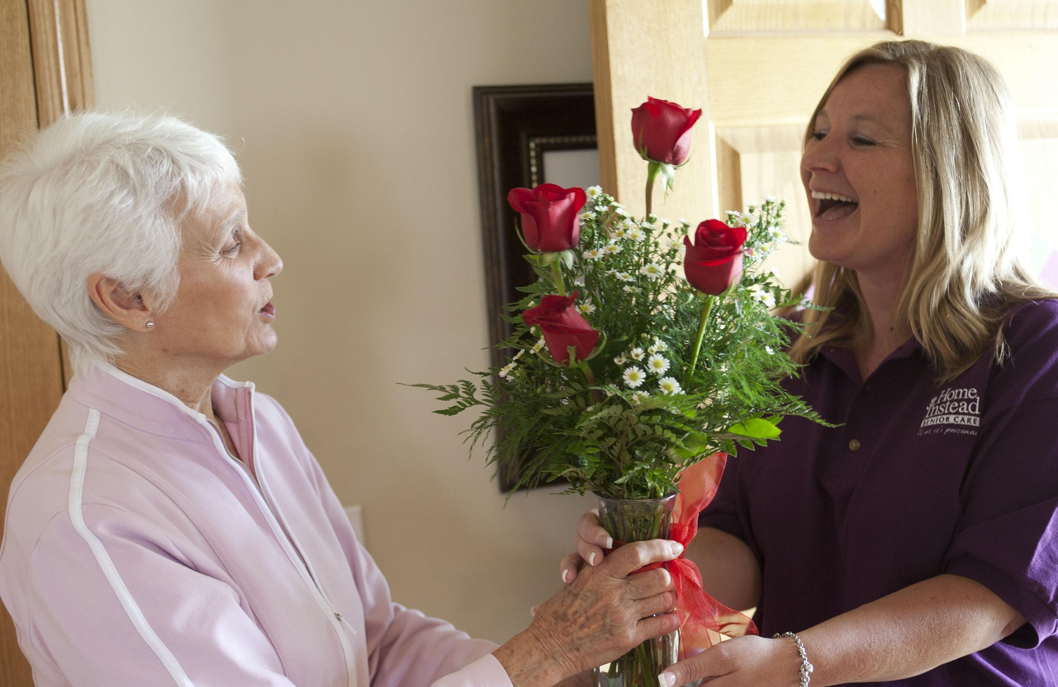 Client and CAREGiver putting flowers in a vase