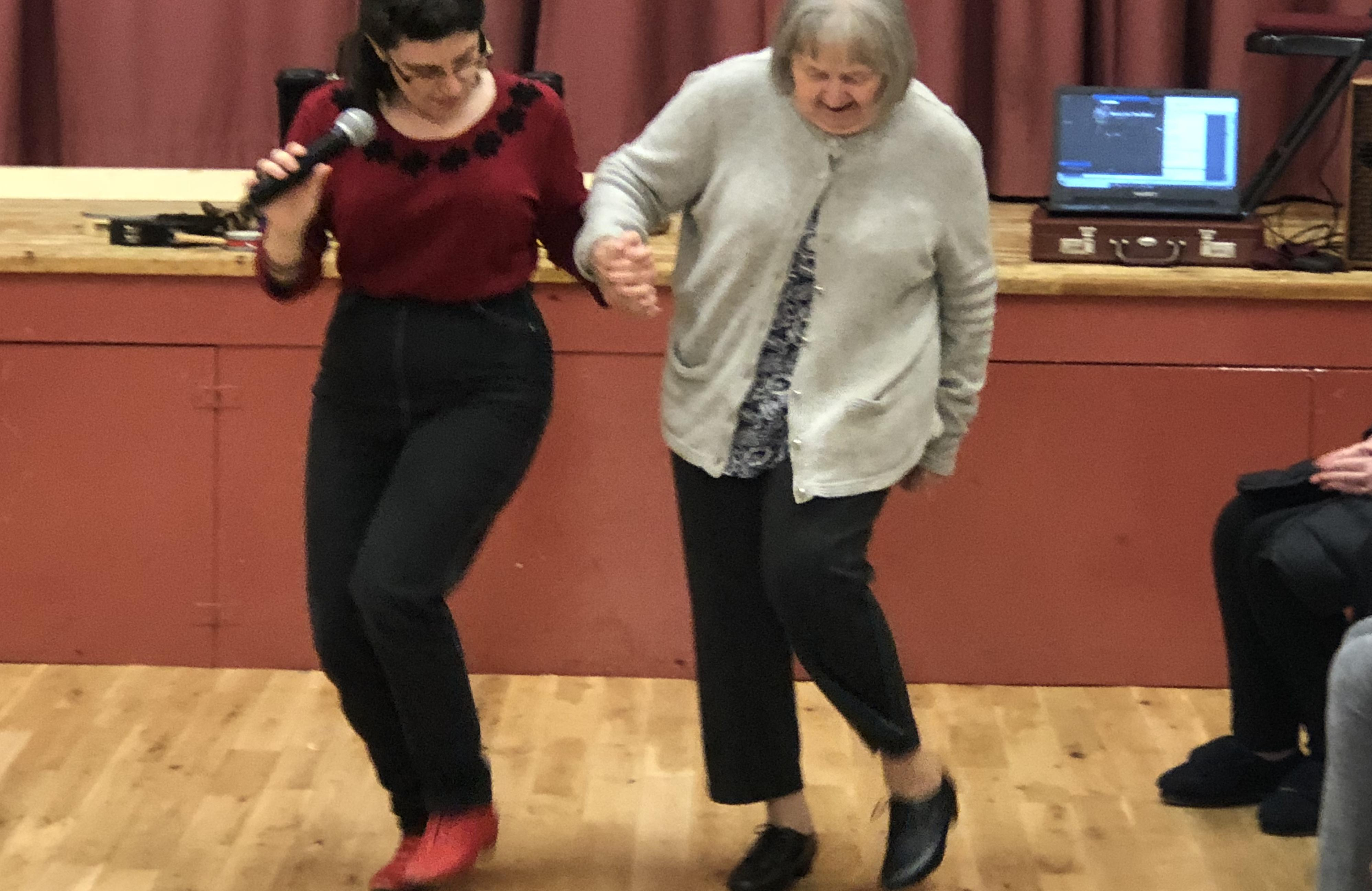 Becki getting people active at Home Instead Havant's Music for the Mind