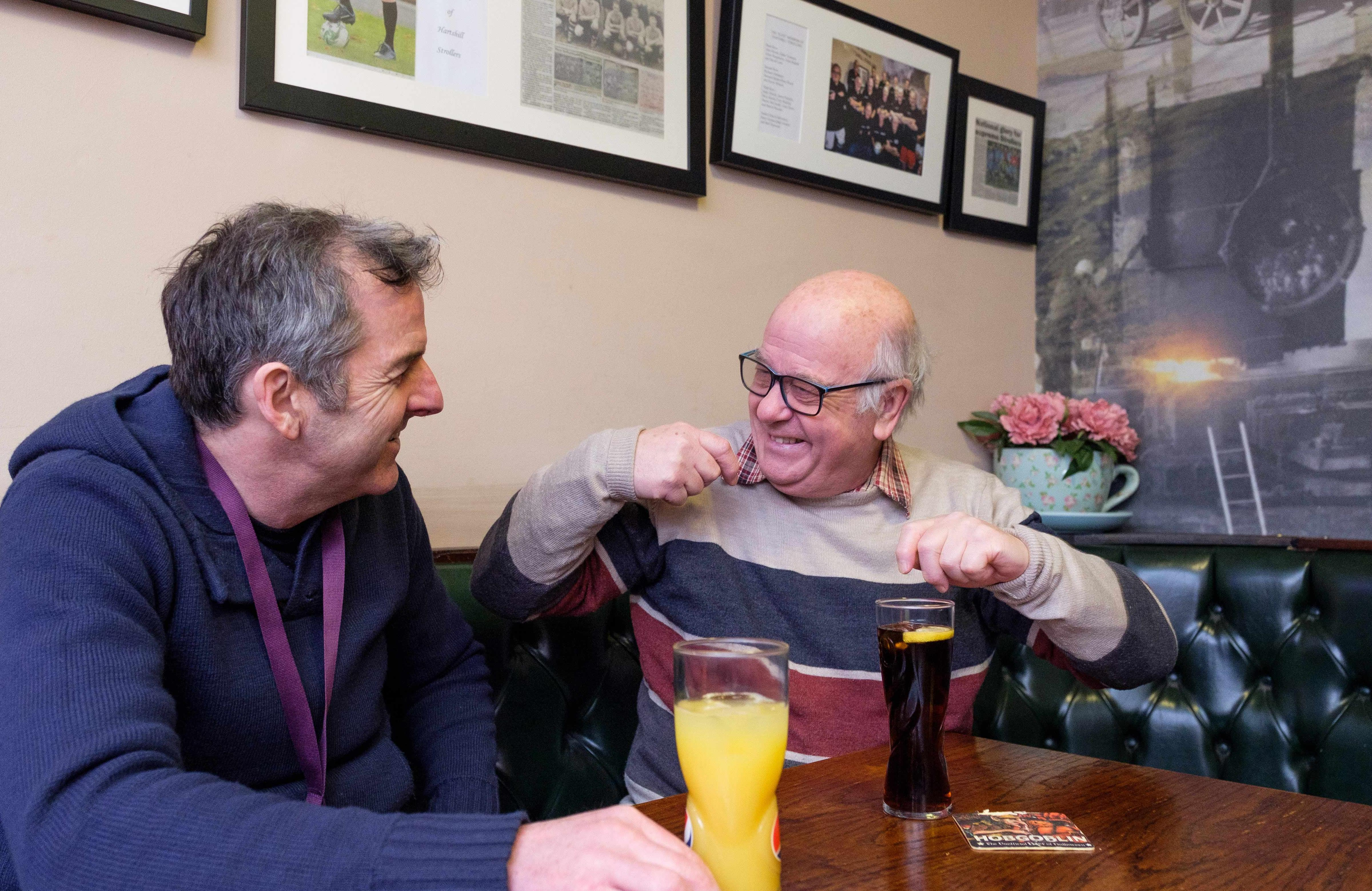 elderly man has a drink with Rotherham CAREGiver