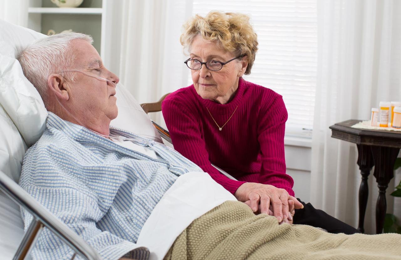 older man with Rotherham CAREGiver at bedside