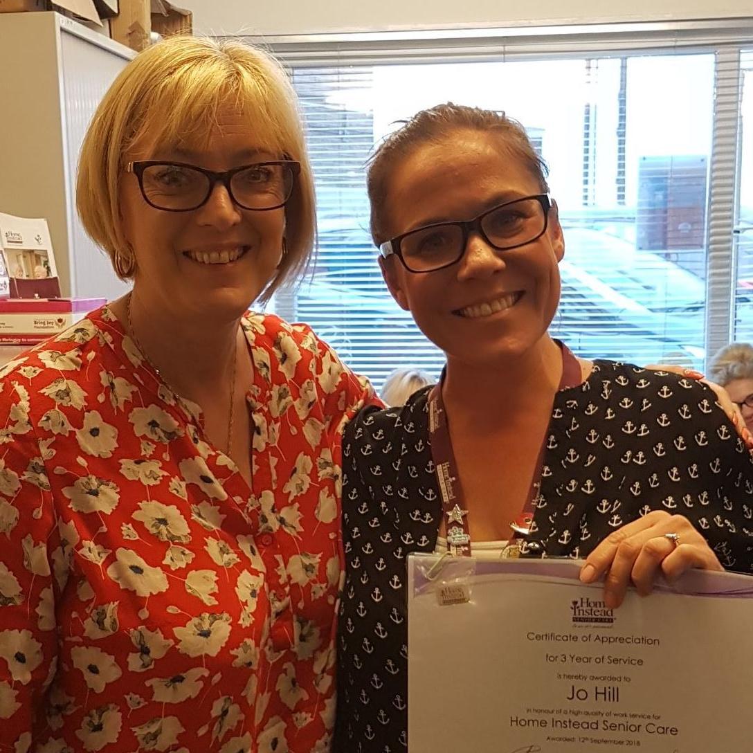 Smiling Jo receiving her award