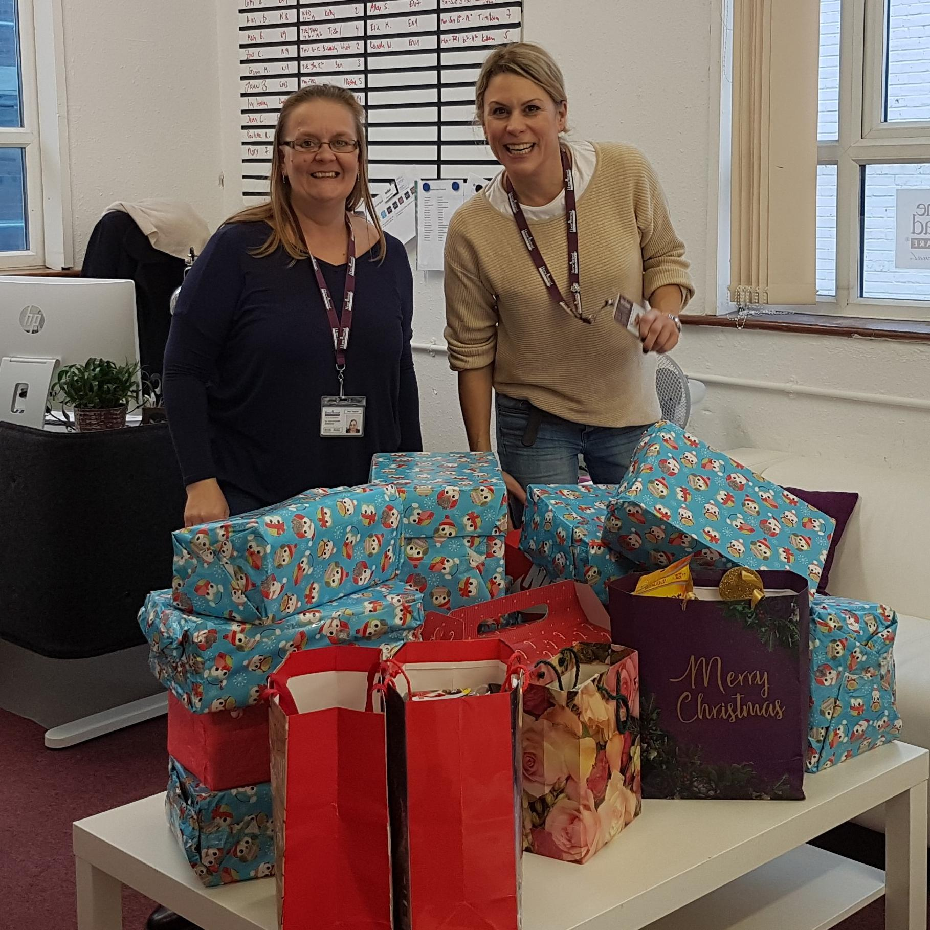 Home Instead Enfield Owner and Care Co-ordinator with Christmas Presents