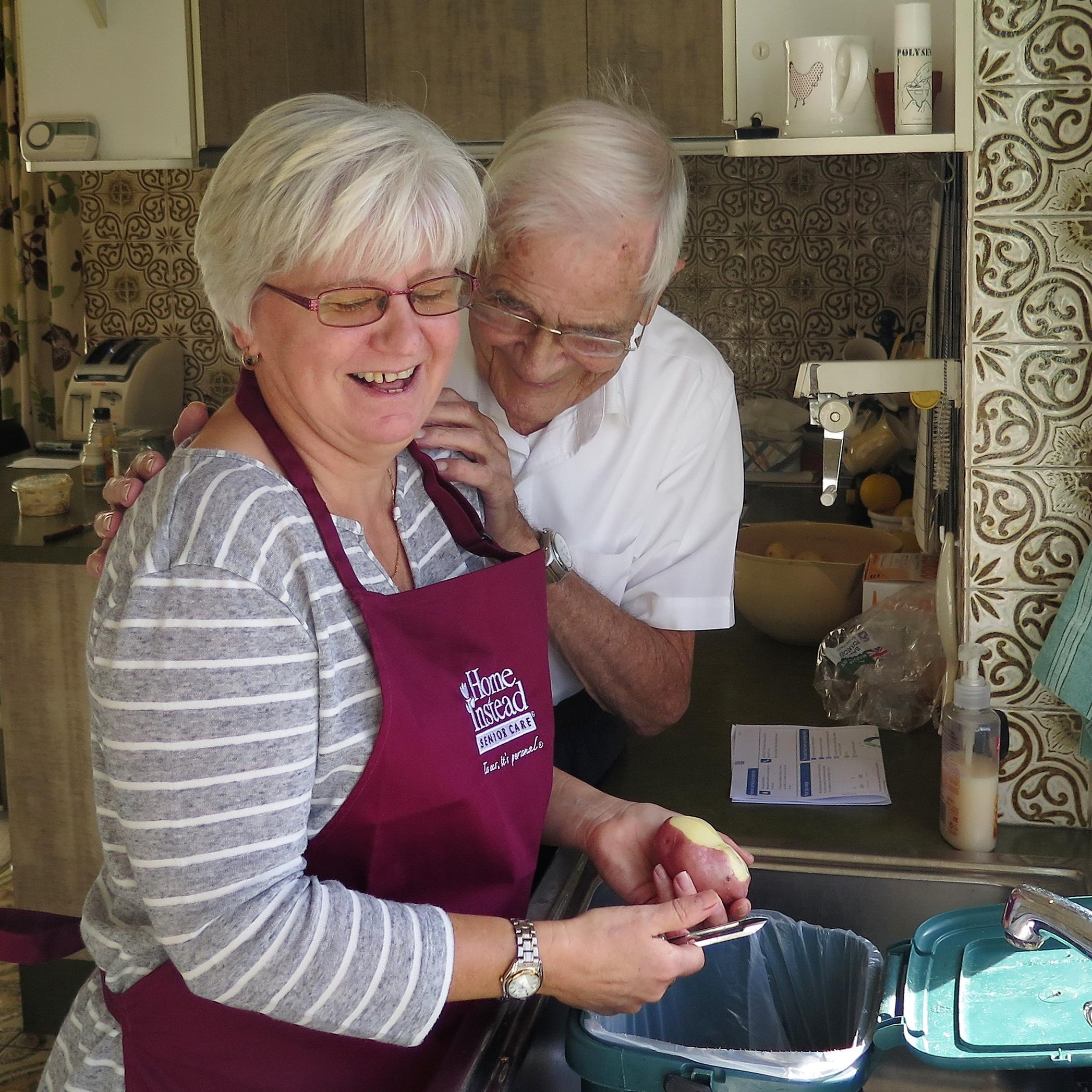 CAREGiver Elaine helping client Ted prepare a meal