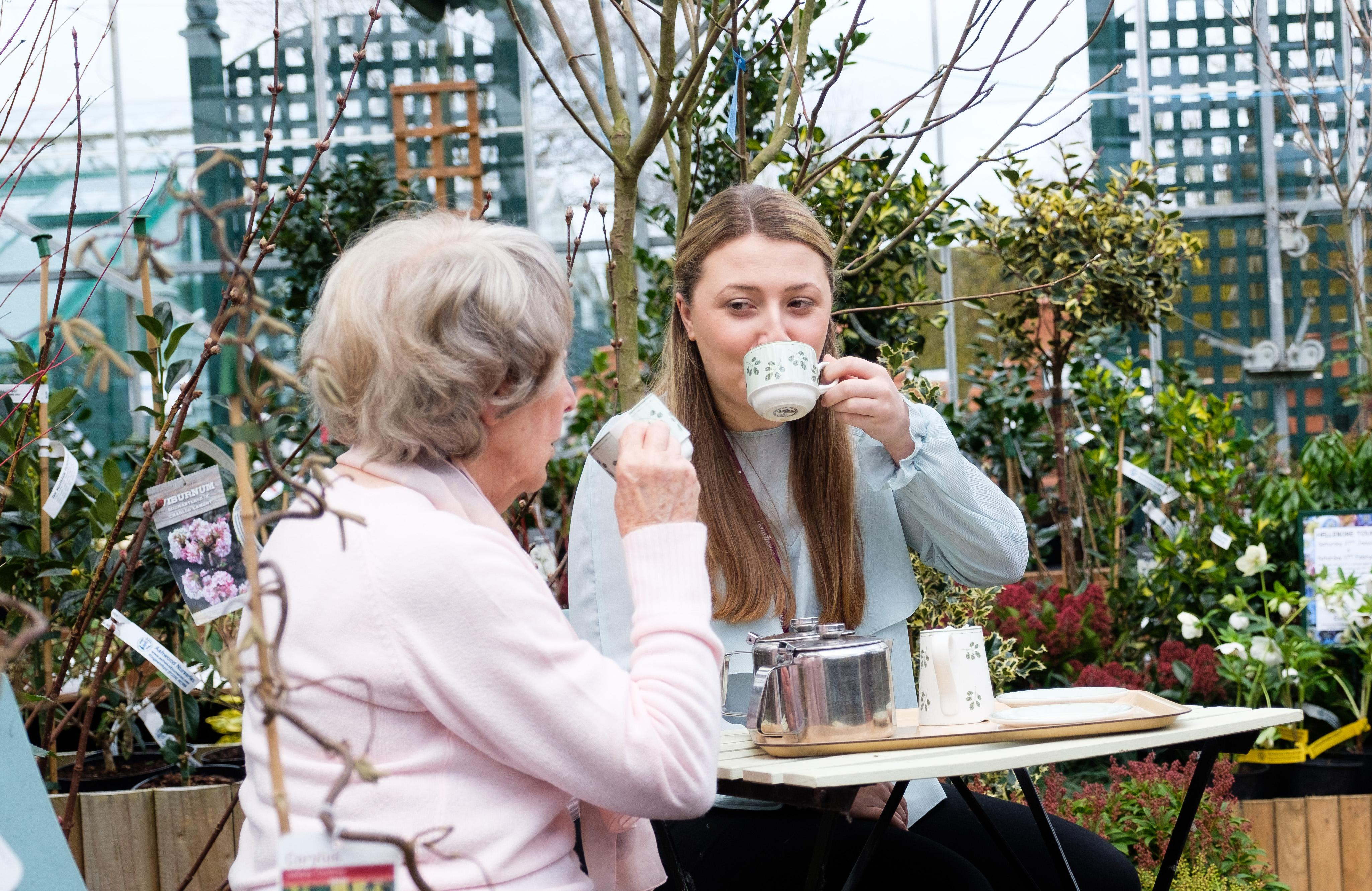 Photo of CAREGiver and client drinking tea