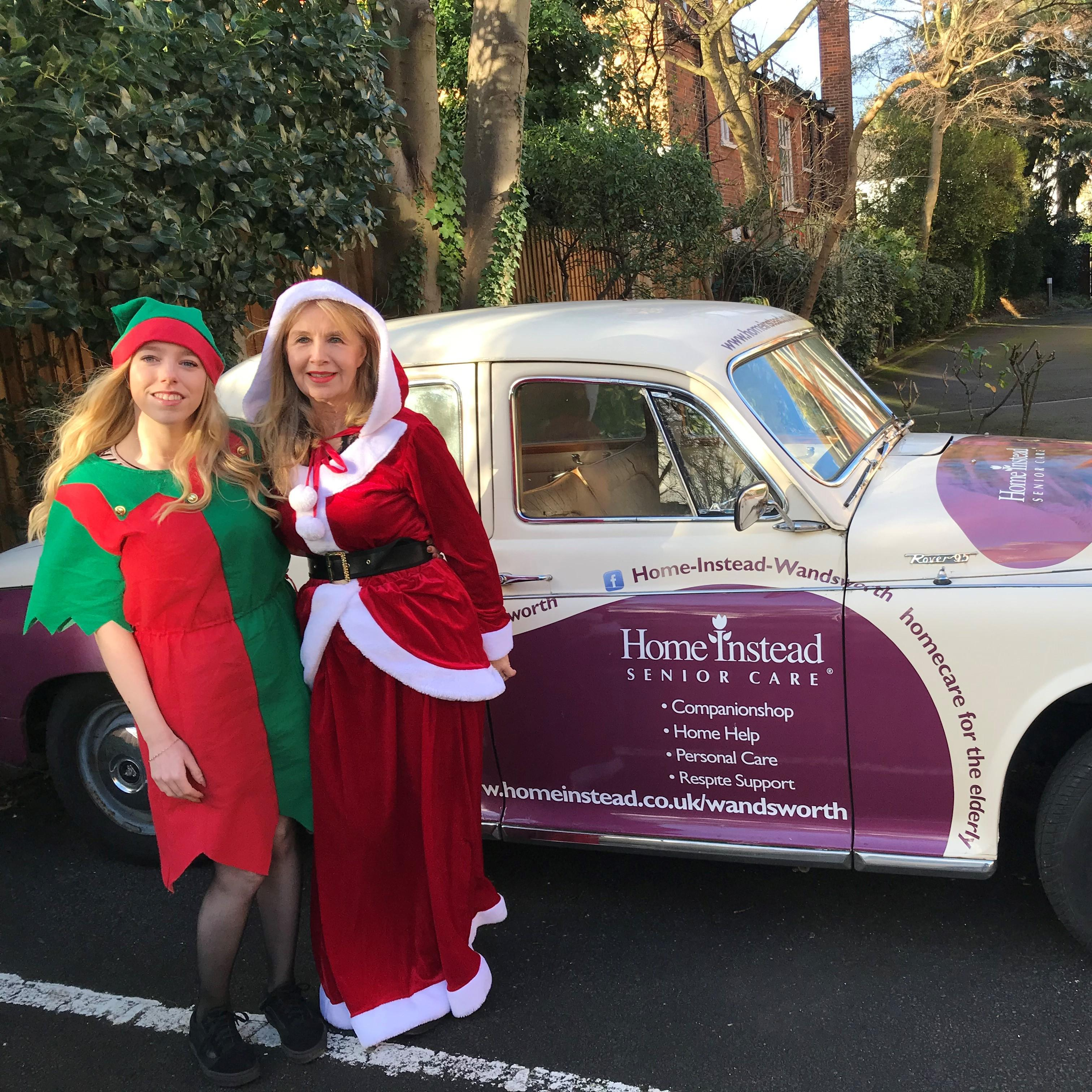 Santa and her Elf arrive in their 1962 Rover, company car