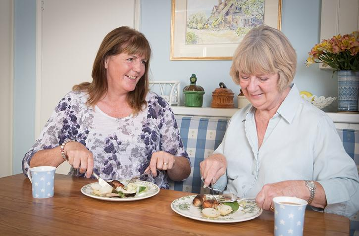 CAREGiver and client eating meal together