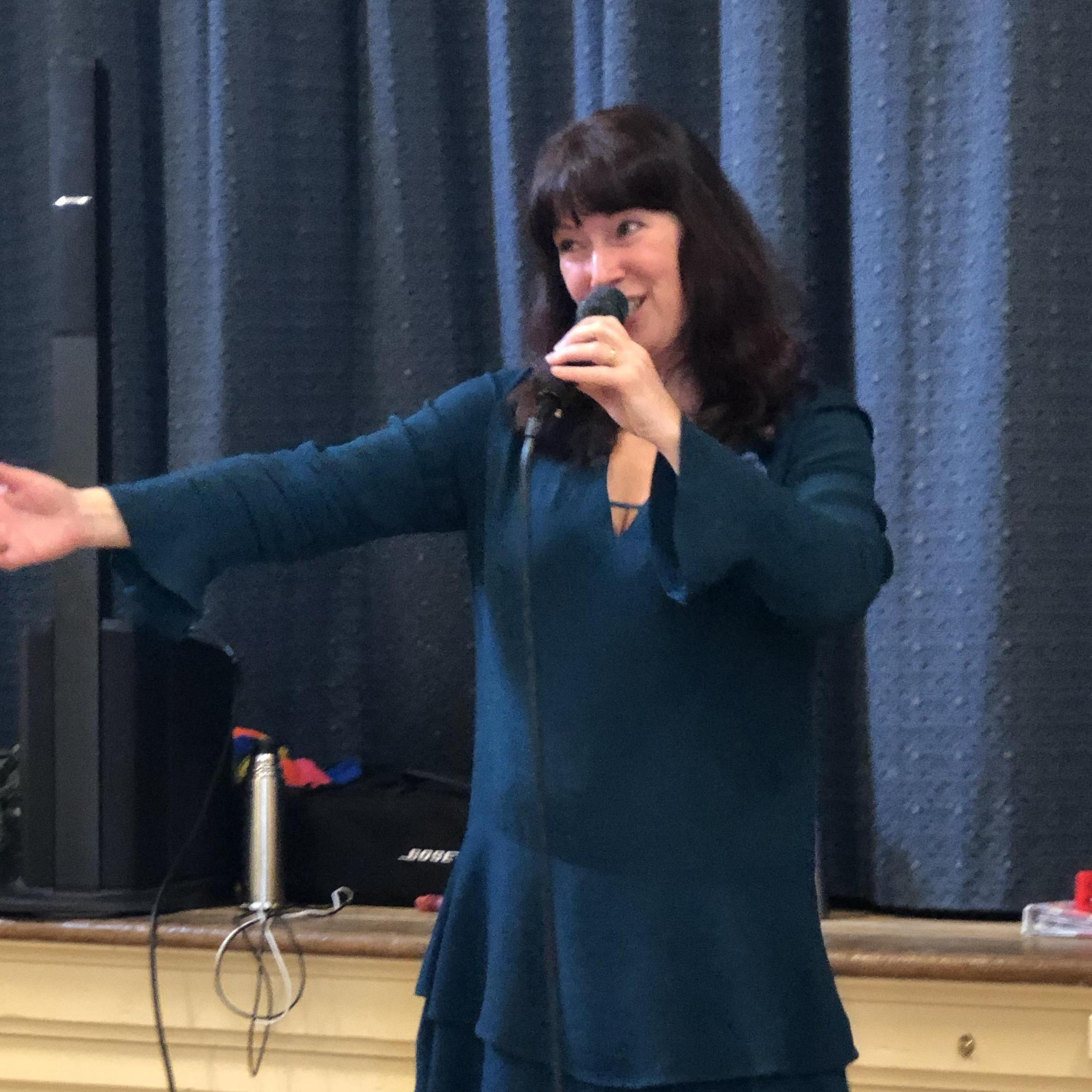 Wendy Evans singing at Home Instead's Community Event in Hayling