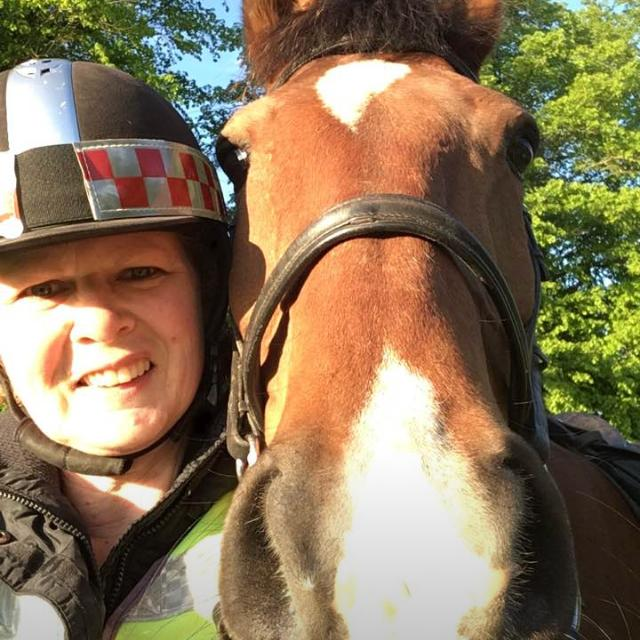 Sally smiling with her horse Shaun