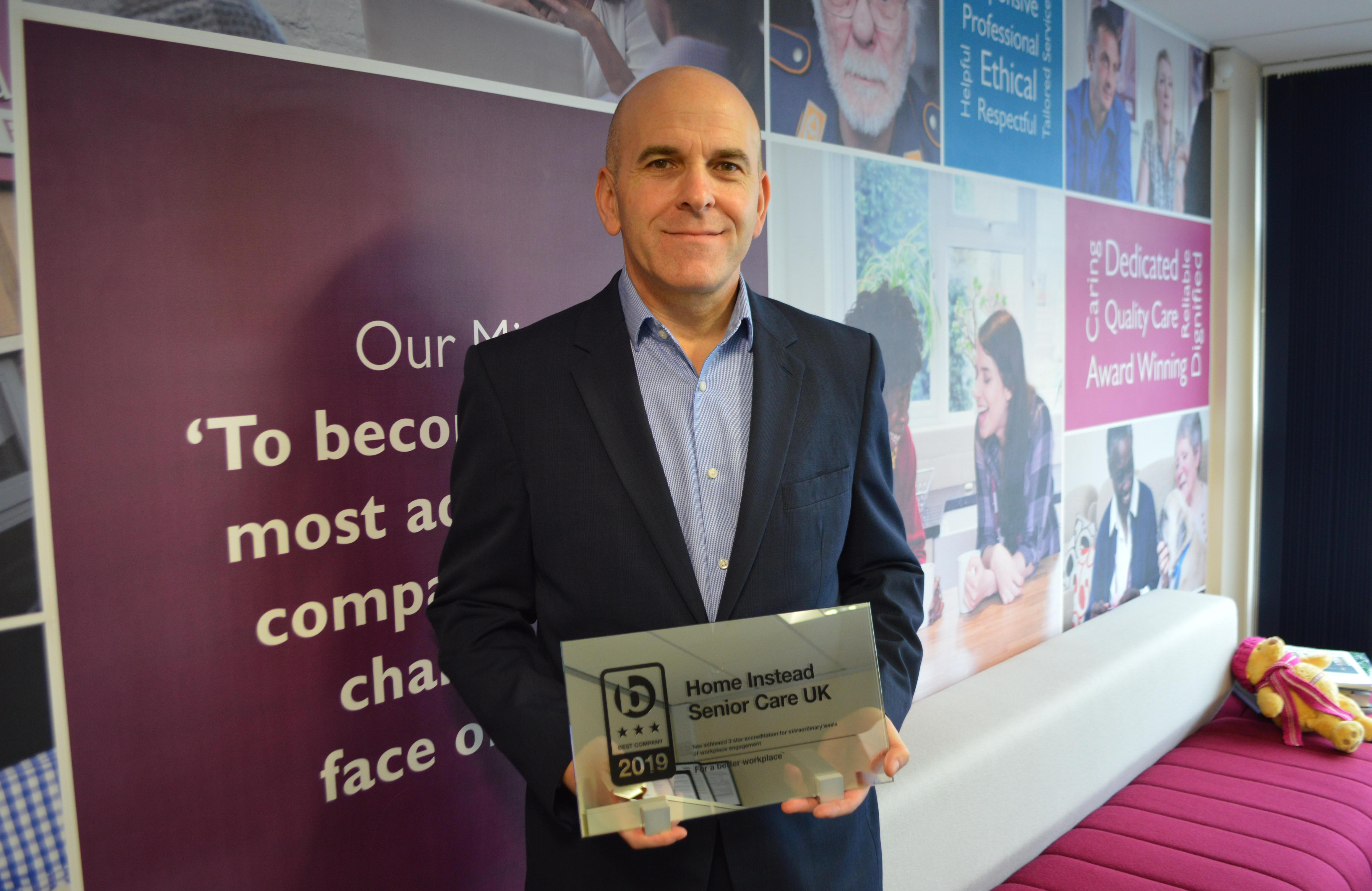 Photo of Martin Jones with the 3 star Best Companies 2019 Award