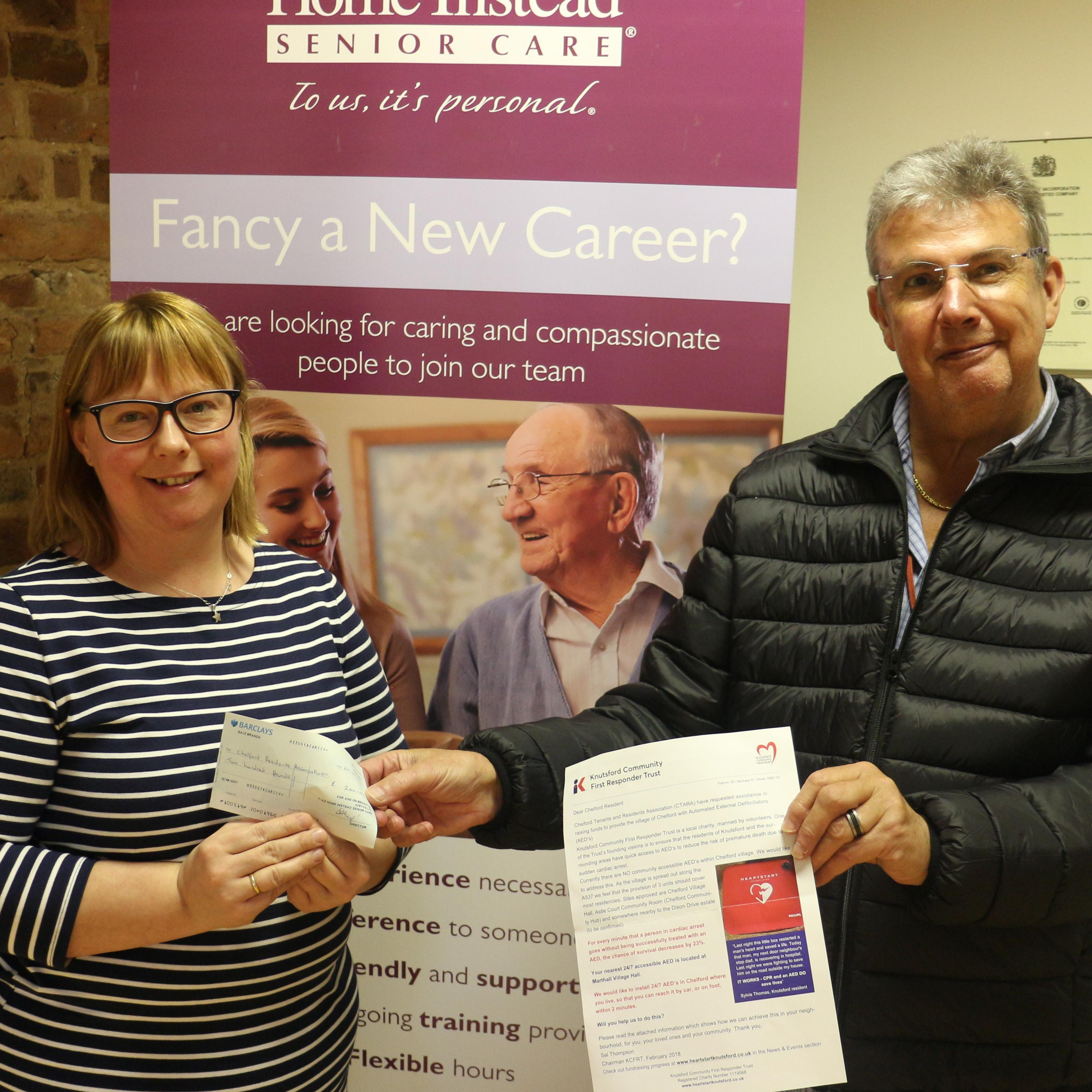 David Kent receives a cheque from Kinga