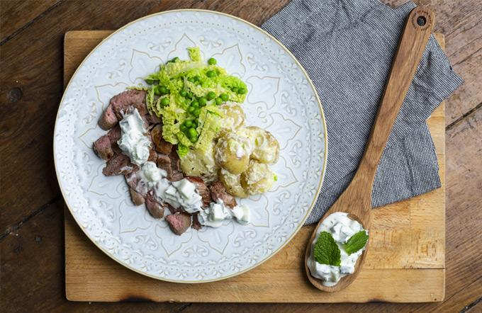 Photo of roast lamb steak with mint and cucumber yoghurt
