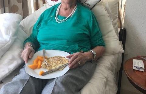 lady eating pancakes