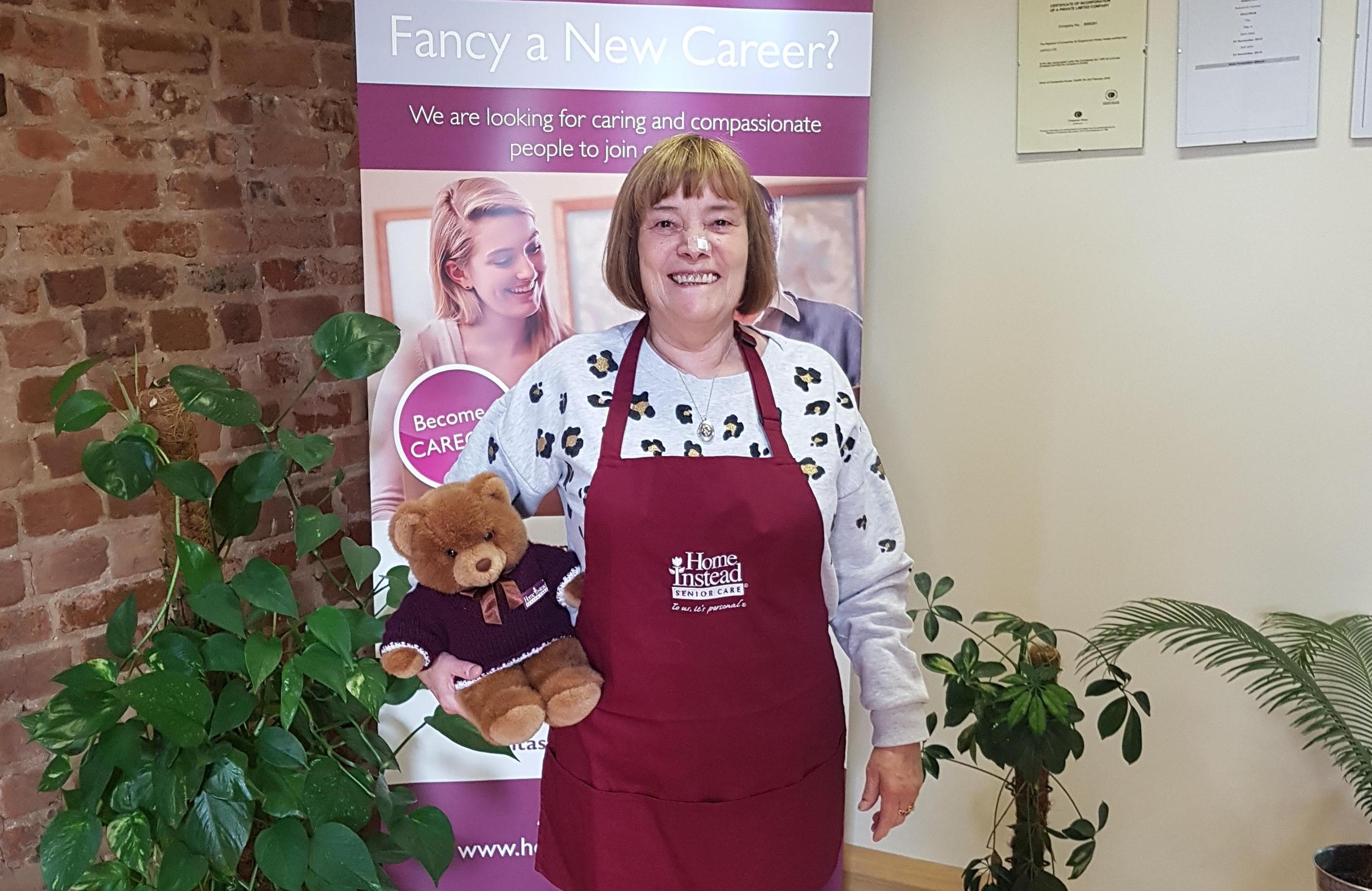 CAREGiver Linda sports her pancake day pinny along with Home Instead Ted