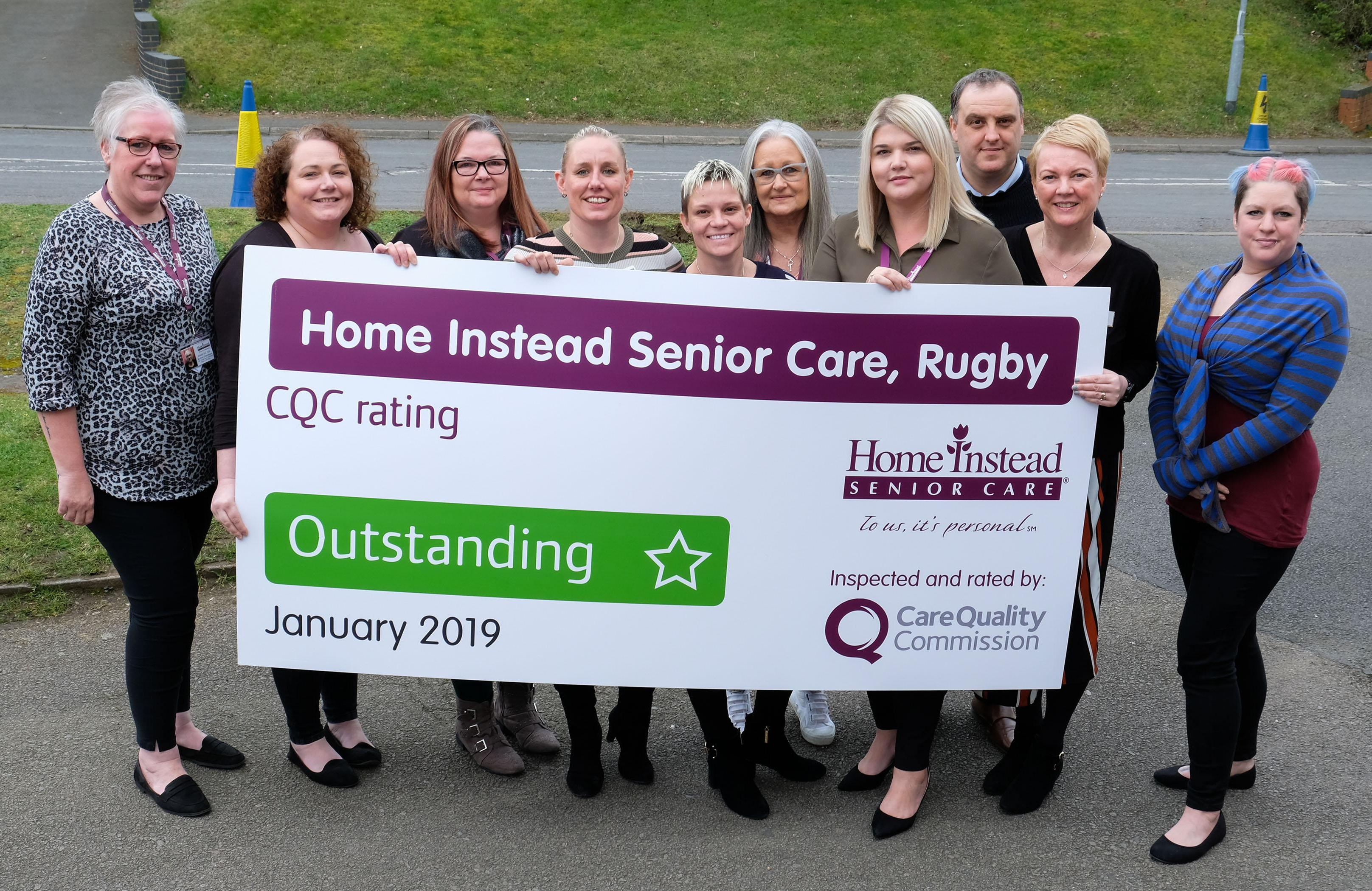 Photo of Home Instead Rugby team with CQC Outstanding banner