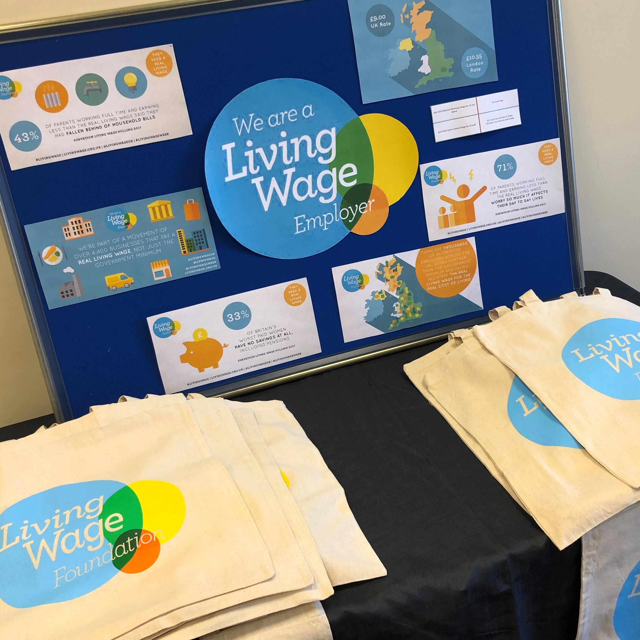 Living Wage Employer Table set up for CAREGiver Day