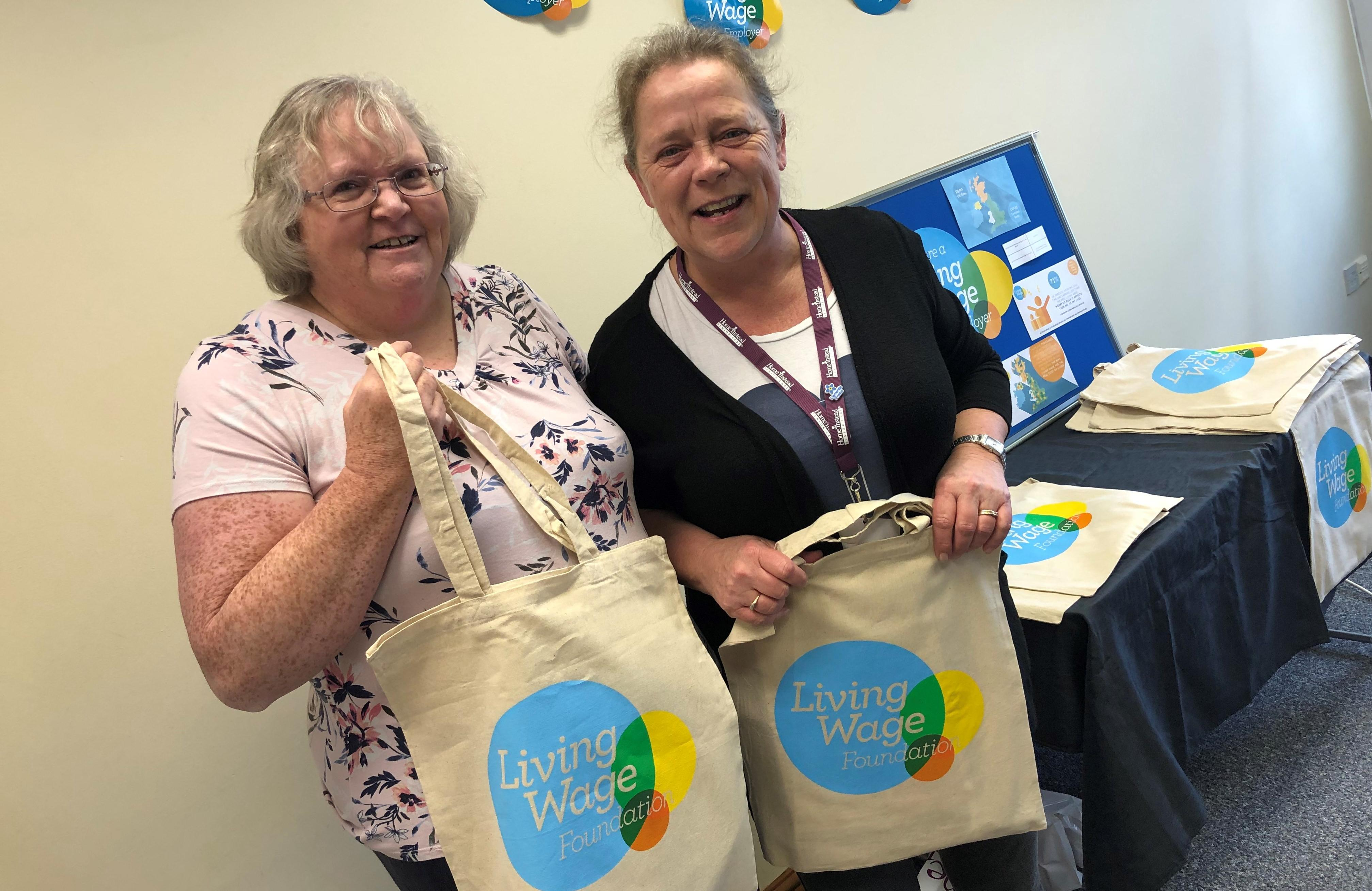 CAREGivers with their Living Wage Employer Goodie Bags