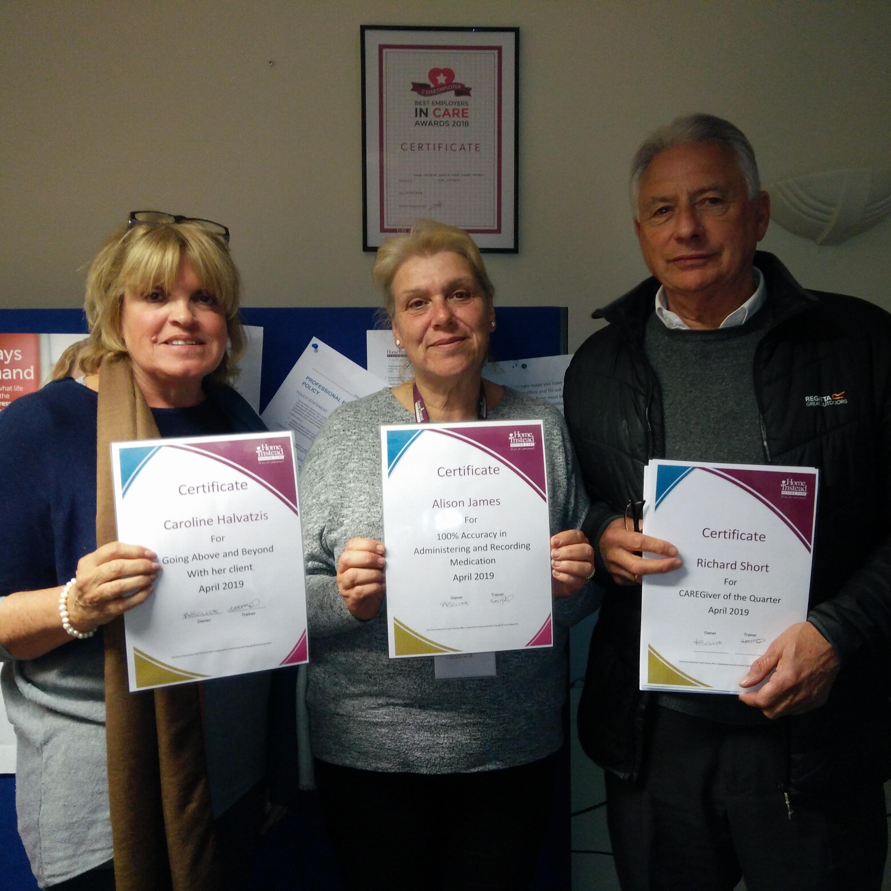 Happy CAREGivers receiving award certificates