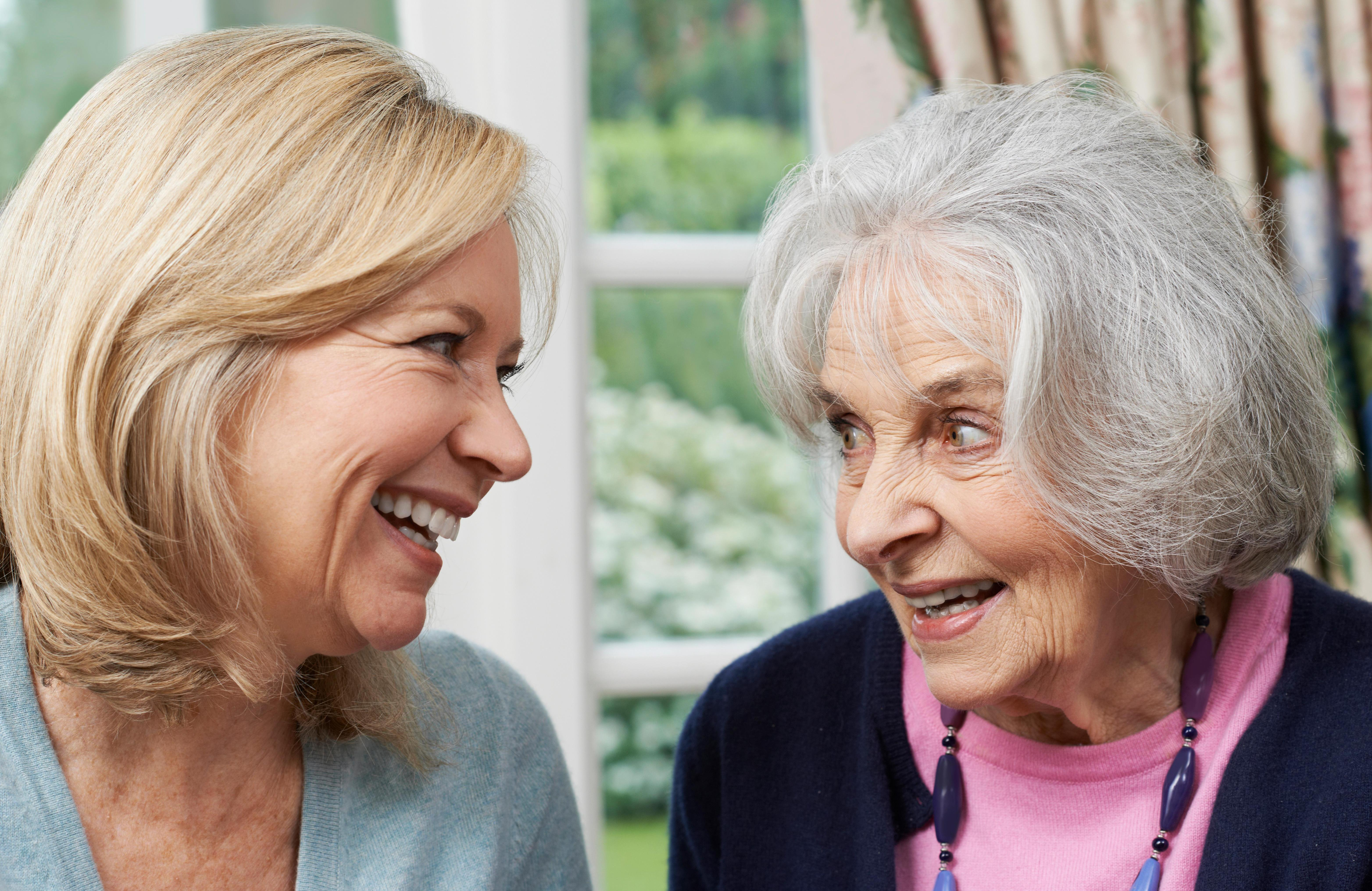 Carer comforting an elderly client suffering with Alzheimer's