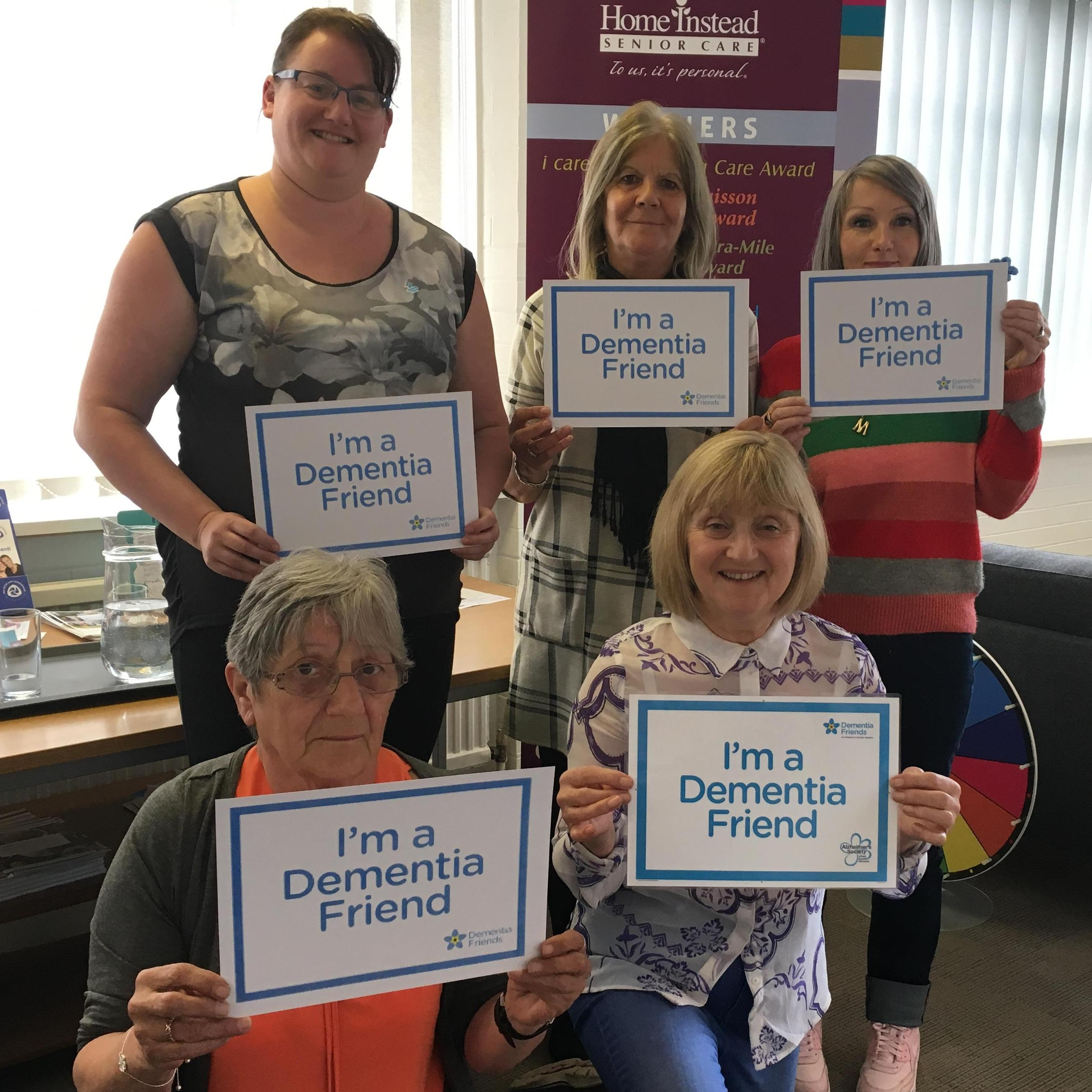 new dementia friends looking towards the camera