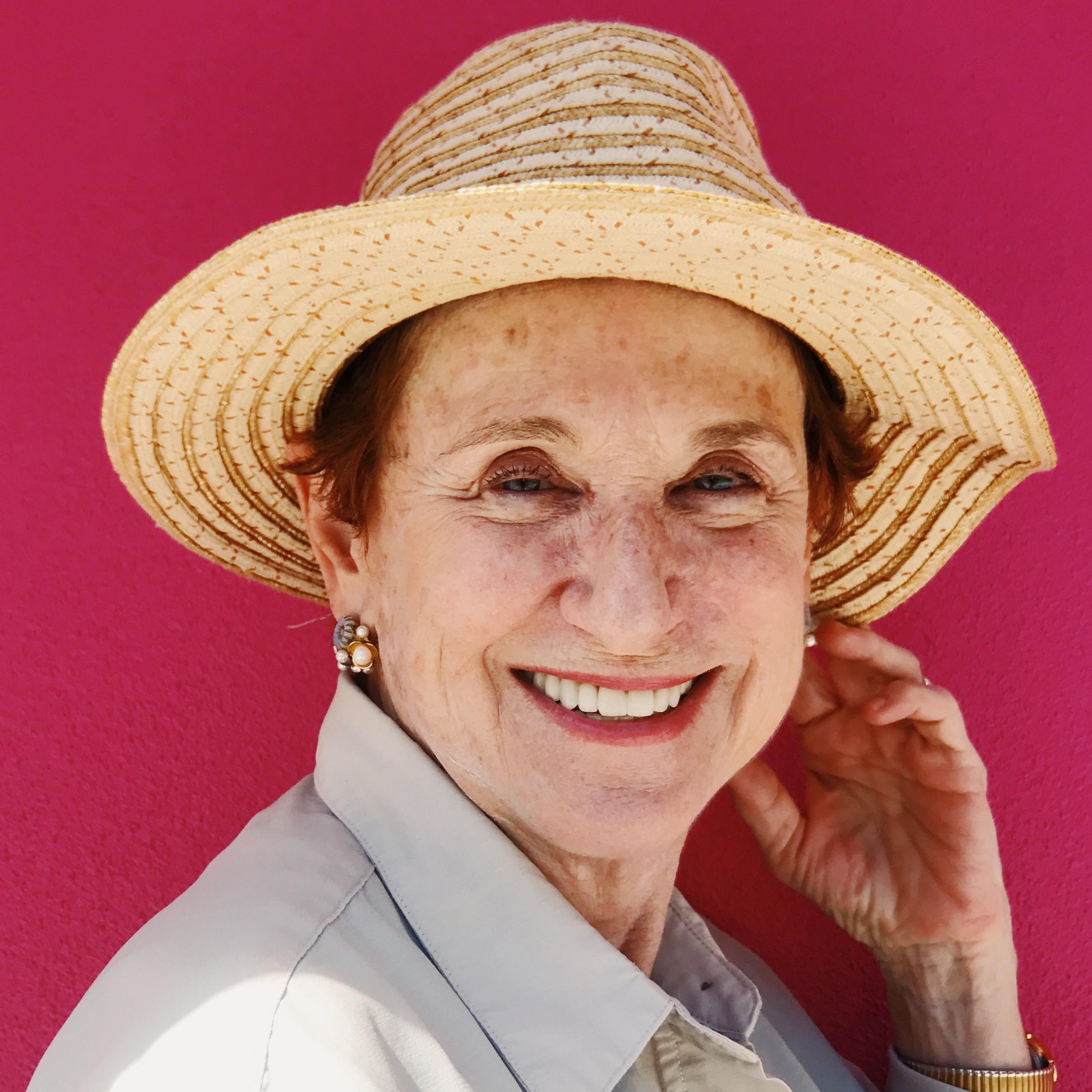 Smiling lady in straw hat