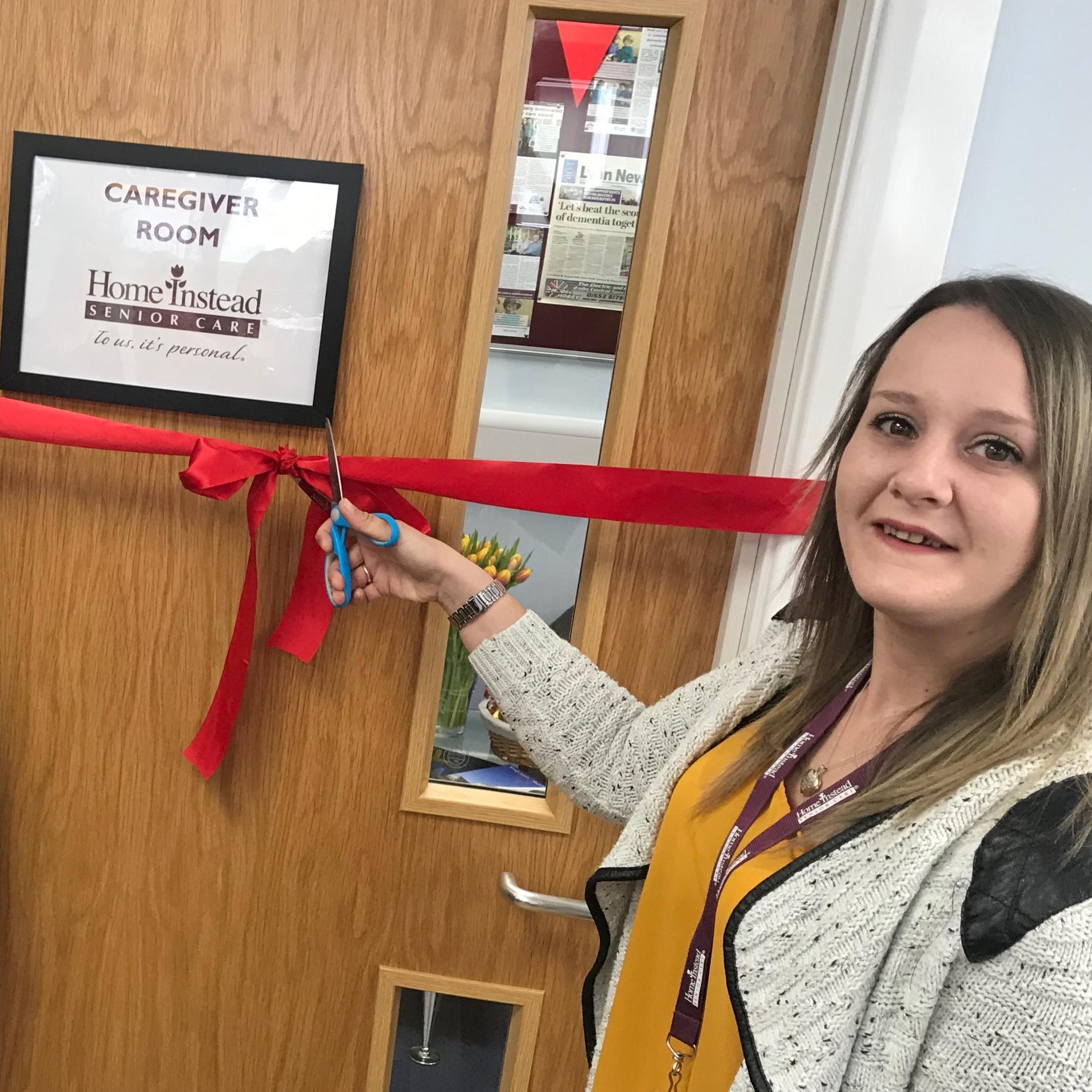 Rachel cuts the ribbon to the new room