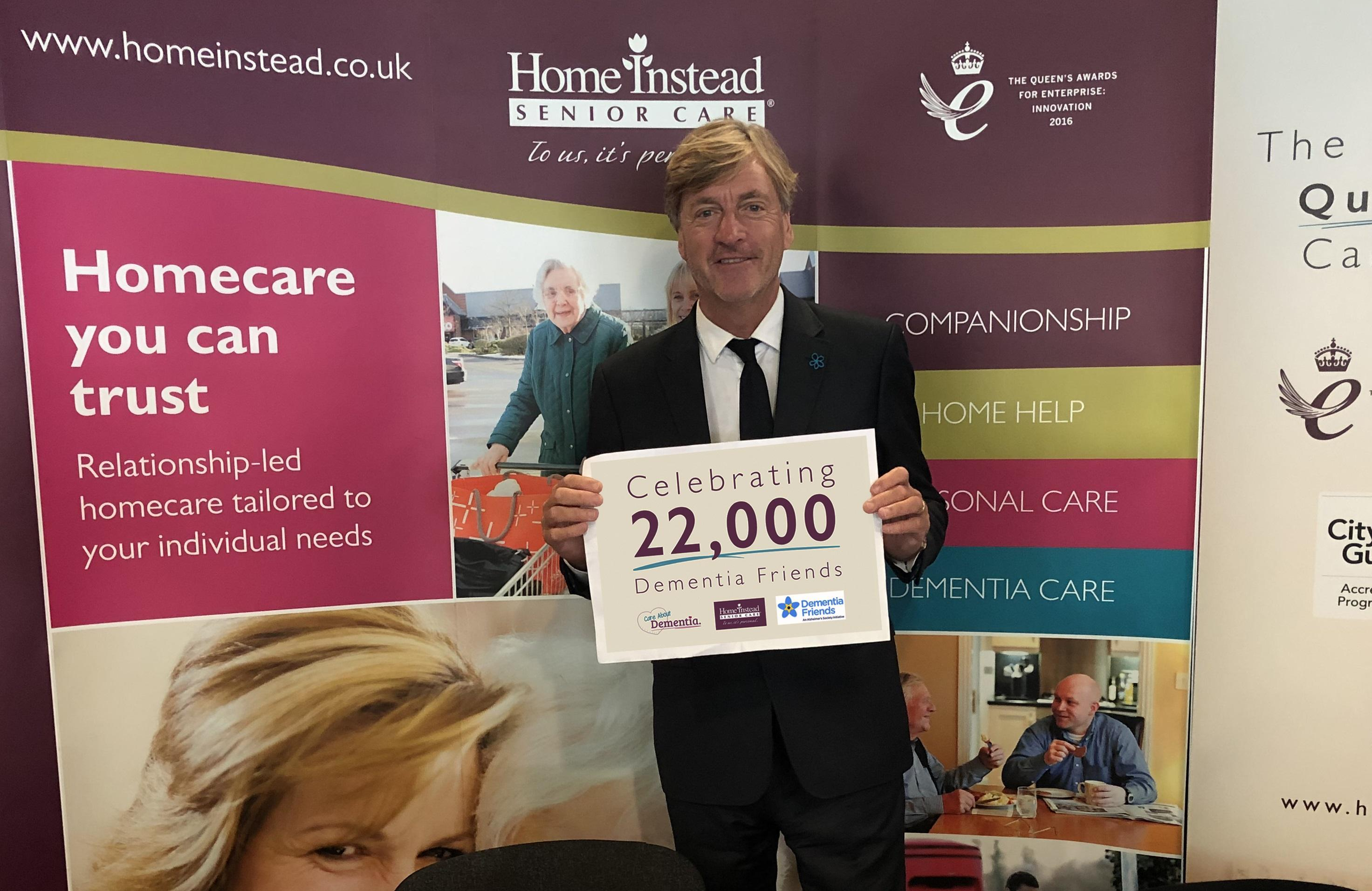 Photo of Richard Madeley with a Dementia Friends sign
