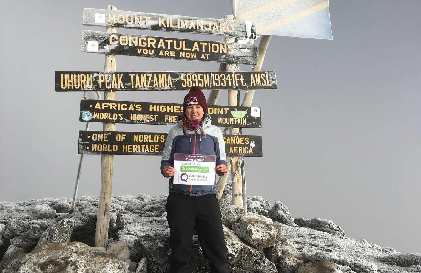 Photo of Fiona Clark at the top of Kilimanjaro