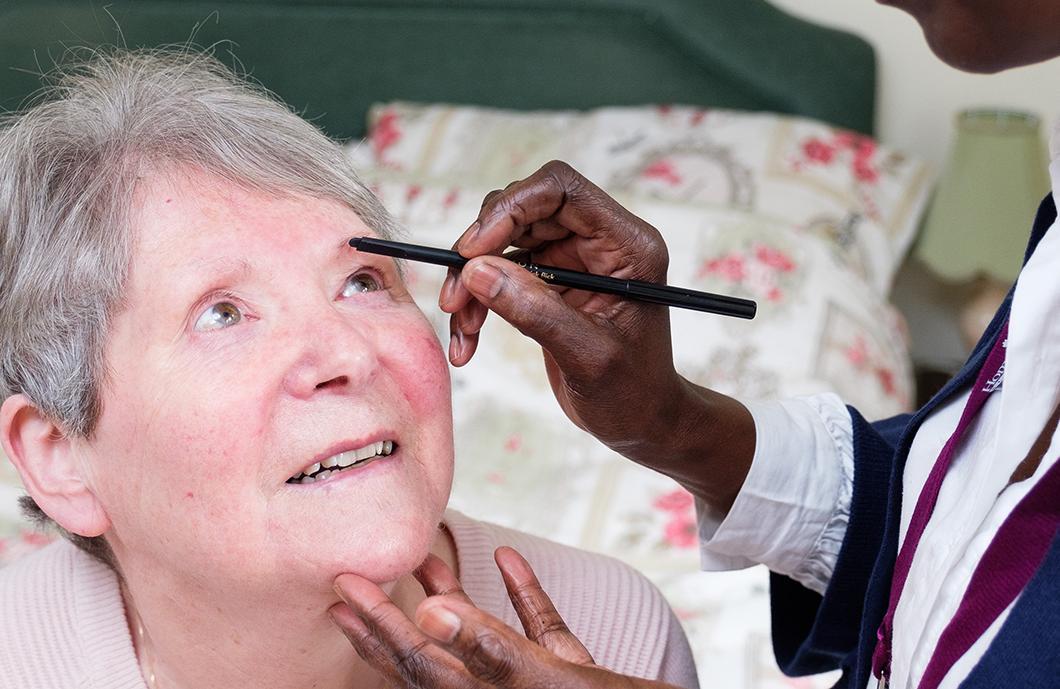 CAREGiver doing Clients Make-Up