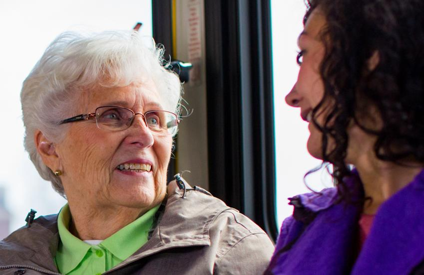 CAREGiver supporting clients on public transport